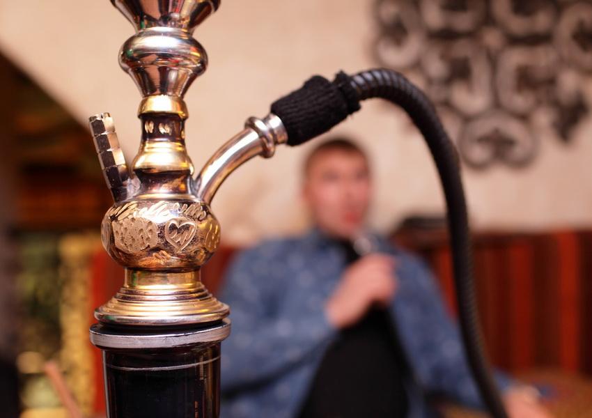 Person smoking shisha in the asian restaurant